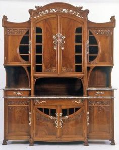 Art Nouveau Carved walnut credenza with textured gold glass cabinet doors, Italy, ca. 1902