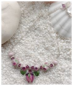 Handmade necklace with beautiful floral lampwork by CCdesign, swarovski-crystals and Sterling silver.  By torill-k