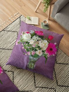A glass vase of flowers. There are pink gerberas, pink carnations, white daisies, white roses, and red roses. A backdrop of dusty pink woven cashmere. Throw Pillows Bed, Bed Throws, Floor Pillows, Decorative Throw Pillows, Red And White Roses, Red Roses, Floral Cushions, Flower Vases, Flowers