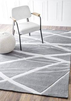 Bring simple luxuries into your home with this hand-tufted rug. This rug is woven into a transitional pattern with hand-carved details. This rug evokes a spa-like aura in any room throughout your home
