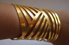 Herve Van Der Straeten Hammered Gold Cutout Cuff | From a unique collection of vintage cuff bracelets at https://www.1stdibs.com/jewelry/bracelets/cuff-bracelets/