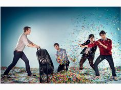 """Vampire Weekend  """"Cape Cod Kwassa Kwassa""""  This photograph demonstrates the principle of showing motion in both of its aspects, blurring and freezing. The photographer uses a fast enough shutter speed to capture and freeze the motion of the band members, but not fast enough to capture the confetti being blown around by the fan.  if the photographer had used a quicker shutter speed and a smaller aperture to freeze the motion of the confetti, I feel the photograph would be more exciting."""