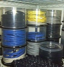 CD and DVD Spindles Serve As Cable Cases