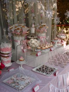 I am in love with this pretty in pink Winter One-derland birthday dessert table set up for a darling one year old named Zoe. Lots of s...