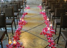 Just the glass containers with floating candles at chairs lining aisle...no petals, please.