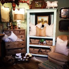 Painted Turquoise cabinet, painted chest, handmade pillows, baskets, oil paintings, toile trays, burlap upholstered wing back chair