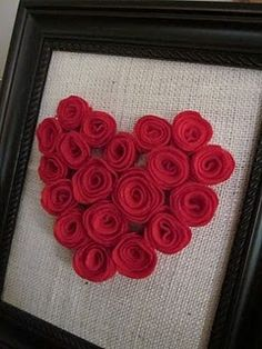 Rolled paper heart, on burlap, framed