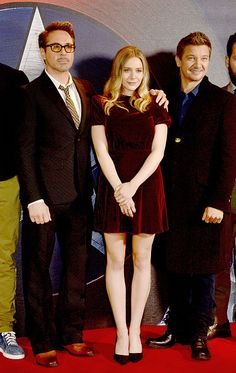 Robert Downey Jr Elizabeth Olsen and Jeremy Renner at a photocall for 'Captain America Civil War' at The Corinthia Hotel London on April 25 2016 in...