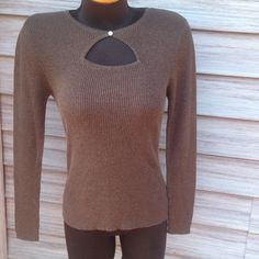 Brown with gold shimmer Long sleeves with open detail on front. Silver bottom with rhinestones is missing one stone. See picture. Size says XL but it fits like a small medium. KIKIT Sweaters