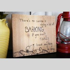This is a one of a kind hand burned wooden plaque, featuring an image of Snoopy and a fun saying.