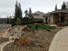 New front yard: drought tolerant landscape. Dry creek bed, artificial turf