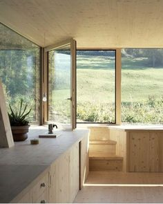 House in Balsthal is a timber house in northern Switzerland with rectangular and round windows. Completed in 2013 the home was designed by Pascal Flammer. Wood Exterior Door, Interior And Exterior, Modern Exterior, Interior Stairs, Ideas Cabaña, Swiss House, Swiss Cottage, Timber House, Wooden House