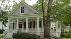 One day I want a house with wrap around porch just like this!