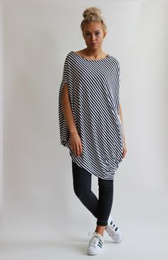 Quirky asymmetric cut top in striped fabric with side draping.