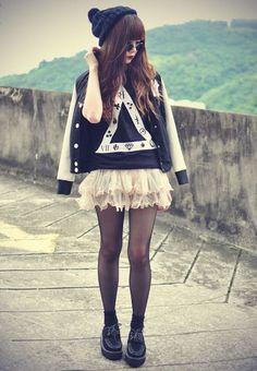 The letterman jacket/ ruffle skirt combo is amazing