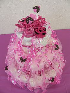 Diaper cake...lots of ribbon, rolled up baby socks for topper and more Sizzix ladybugs made with scrapbook paper.