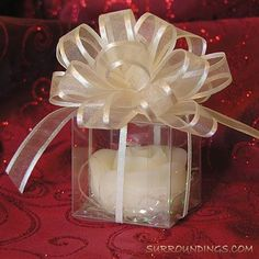Silk Pull Bows Just pull inner ribbon and you've got a beautiful bow. Bows are sheer with a satin edge. Ribbon is and are sold in package of 12 bows. Mason Jar Candle Holders, Candle Favors, Mason Jars, Clear Favor Boxes, Pull Bows, Floating Candle Centerpieces, Tabletop Accessories, Gift Bows, Rose Buds