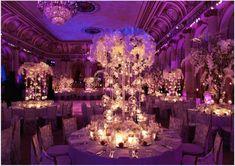 White centerpieces with purple lighting. Wedding reception. Wedding decor