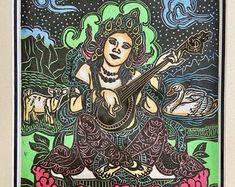 Tula Saraswathi, Saraswathi goddess of music and art, Everyday Goddess, Saraswati w goat and swan, Mokuhanga woodblock, Buddha woodblocks - Edit Listing - Etsy Thangka Painting, Hindu Art, Buddhist Art, Swan, Buddha, Aurora Sleeping Beauty, Carving, American, Music