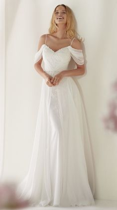 Courtesy of Nicole Spose wedding dresses; www.nicolespose.it
