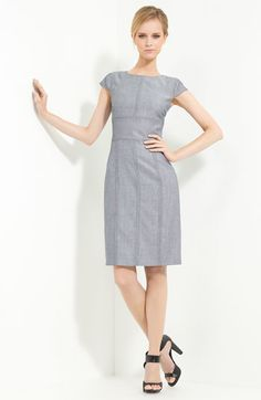 this armani collezioni wool twill dress is cute, but i'd do an edgy black pump with it.