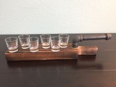 Wood Carved Shot Tasting Set with Shot Glasses (1.5 oz.) included. Galvanized Steel Pipe handle inserted to give balance with full shot glasses. Full Shot glasses means a good time! This unique shot tasting set was created after an inconvenient mishap at a party. Each paddle is