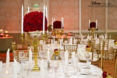 Beauty and the Beast inspired reception with gold candelabras and chiavari chairs and red rose centerpieces