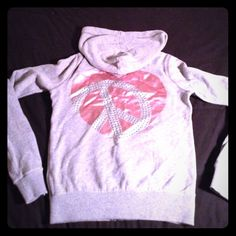"""Victoria Secret """"Pink"""" Hoodie Front of hoodie has two hearts one at the top left and one in the right left hand corner on the pocket back of hoodie has a large heart adorned with silver studs item has been gently used no tears, no missing studs, no stains or holes its in great condition only thing Is the drawstring on the hoodie is missing PINK Victoria's Secret Tops Sweatshirts & Hoodies"""