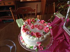 Butter cream icing on a three layer birthday cake.  Flowers were made from marshmallow fondant.