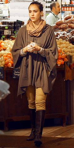 JESSICA ALBA  The actress stylishly accessorizes her earth-toned poncho and mustard skinnies with a cozy scarf, bold Wildlife by Heidi Klum earrings and chocolate boots while browsing the produce aisle at Whole Foods in Beverly Hills.