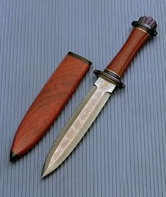 Viking dagger with scroll Damascus blade. I like these boot daggers...