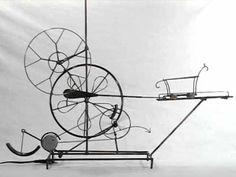 Motion for motion, sake. Small, steel kinetic sculpture running on 12 volts. http://larrylawrenceart.com