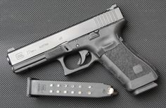 Glock 22 Gen4. (Generation 4)   Required by about 95% of police departments as the weapon they carry on duty.