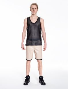 Model is wearing: beige COMBO shorts made of eco-leather & black tank top made of perforated eco-leather