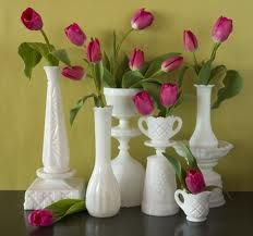 assorted milk glass with soft pink tulips or roses or mini callas
