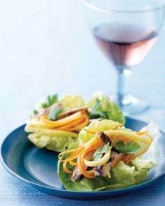 Thin strips of green mango and carrot add a satisfying crunch to these cocktail party-ready appetizers.
