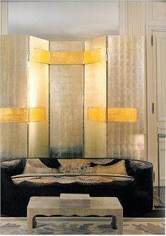 A vintage screen and French Art Deco furniture in a Paris flat designed by Jacques Granges.