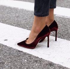 Burgundy velvet heels.