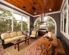I like how you have a seating area and dining.... grill in four season porch?? love it!!!!!