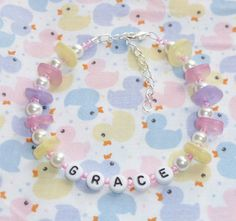 Pastel Inspiration bead and button bracelet  by NiNEFRUiTSPiE, £3.00