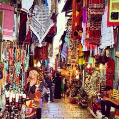 """Shopping in Israel marketplace in Ben Yehuda Street, known as the """"Midrachov"""" is a major street in downtown Jerusalem, Israel. It is now a pedestrian mall and closed to vehicular traffic. The street runs from the intersection of King George Street to Zion Square and Jaffa Road."""
