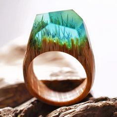 They have scenes ranging from this bright and colourful underwater landscape… | These Rings Have Tiny Forests Inside Of Them And They're Enchanting AF