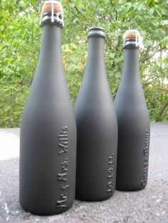 Chalkboard champagne bottles.  1. Scrub labels off bottles. 2. Write what you want with puff paint. 3. Do another layer of puff paint to really make it stand out. *DO NOT TAKE OFF METAL PROTECTOR* 4. Wrap cork and protector with masking tape. 5. Paint with chalk board paint/spray paint.    this could be done with existing canisters or jars