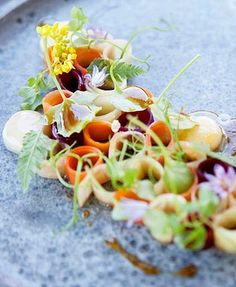 Pickled vegetables and flowers with smoked bone marrow and herbs from Noma restaurant.