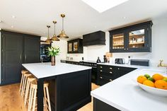 We recently fitted this beautiful bespoke kitchen for a lovely couple in Kent. The dark cabintery is hand painted in Mylands 'Sinner' and finished with brass handles and hinges. This kitchen is in our Westminster range - a classic framed shaker style. Open Plan Kitchen Dining Living, Open Plan Kitchen Diner, Kitchen Size, Open Concept Kitchen, Living Room Kitchen, Home Decor Kitchen, New Kitchen, Home Kitchens, Kitchen Black