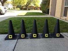 Spray paint orange safety cones black and glue cut out buckles on with a hot glue gun.