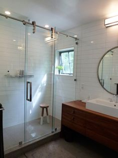Industrial shower, linear tiles but not metro, white combined with warm wood