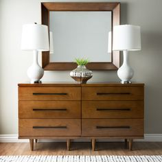 Brighten up your home with this beautiful brown 6 drawer dresser with a wood construction. The furniture piece measures 39 inches high and 45 inches wide for ultimate storage.