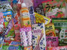 Japanese candy, including: Hi-Chew, Shigekix, Ramune candy, and a sparkling orange drink. Yum!