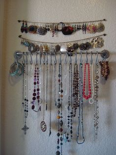 (Google image only) if you don't use your towel rod, like me, use curtain hooks for your necklaces and bracelets. Use thumb tacks and yarn for earrings